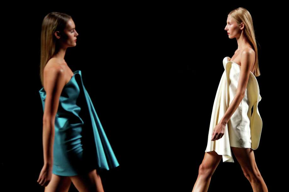 Models walk the runway in the AA de Amaya Arzuaga fashion show. Photo: Carlos Alvarez, Getty Images / 2012 Getty Images