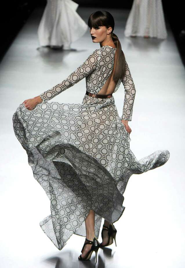"A model presents an outfit during the ""Juanjo Oliva"" show. Photo: DOMINIQUE FAGET, AFP/Getty Images / 2012 AFP"