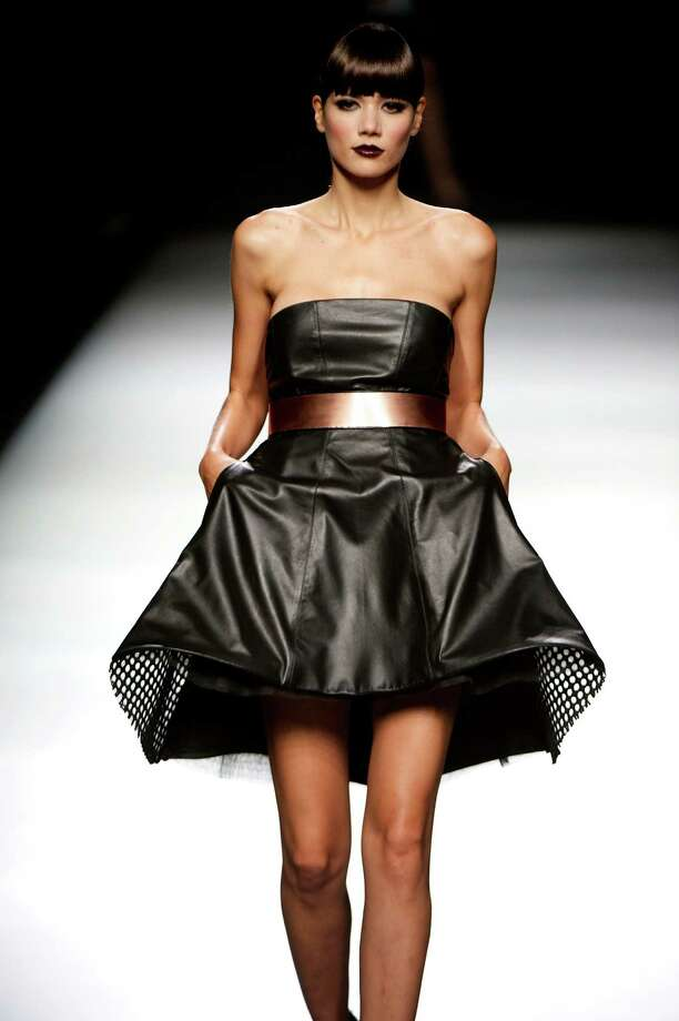 A model walks the runway in the Juanjo Oliva fashion show. Photo: Carlos Alvarez, Getty Images / 2012 Getty Images