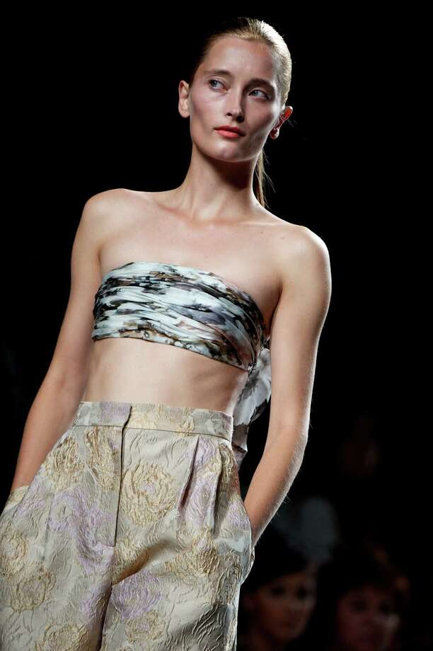 A model walks the runway in the Duyos fashion show. Photo: Carlos Alvarez, Getty Images / 2012 Getty Images