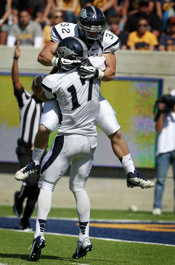 Nevada quarterback Cody Fajardo (17) celebrates the game-winning touchdown with running back Nick Hale in the Cal Bears' 31-14 loss to the Nevada Wolfpack at the renovated Memorial Stadium in Berkeley, Calif. on Saturday, Sept. 1, 2012. Photo: Paul Chinn, The Chronicle