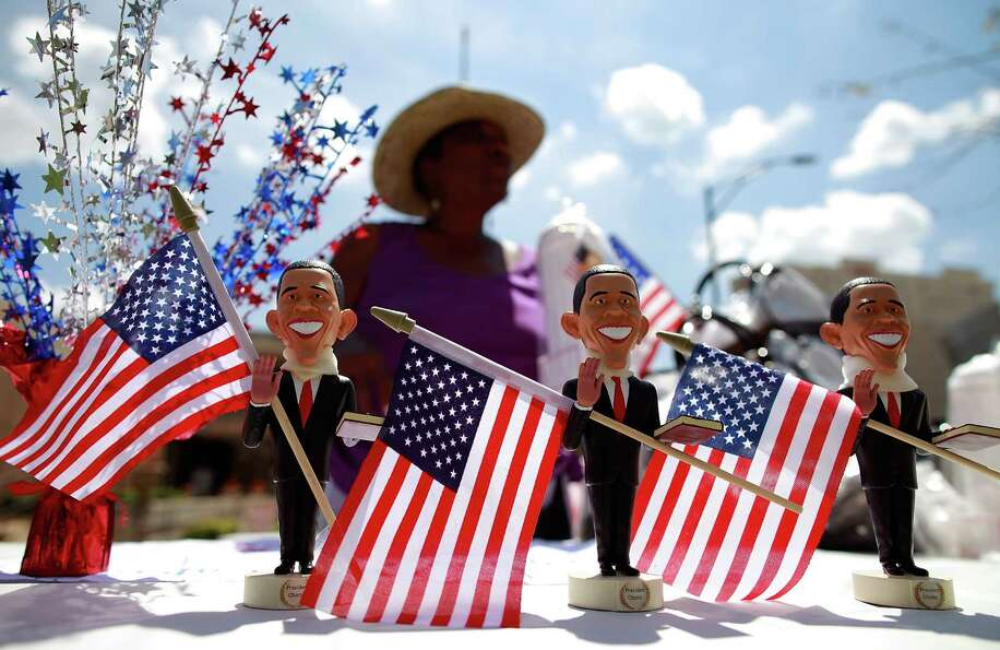 Vendor Chris Belle sells President Barack Obama figures outside the Time Warner Cable Arena on Septe