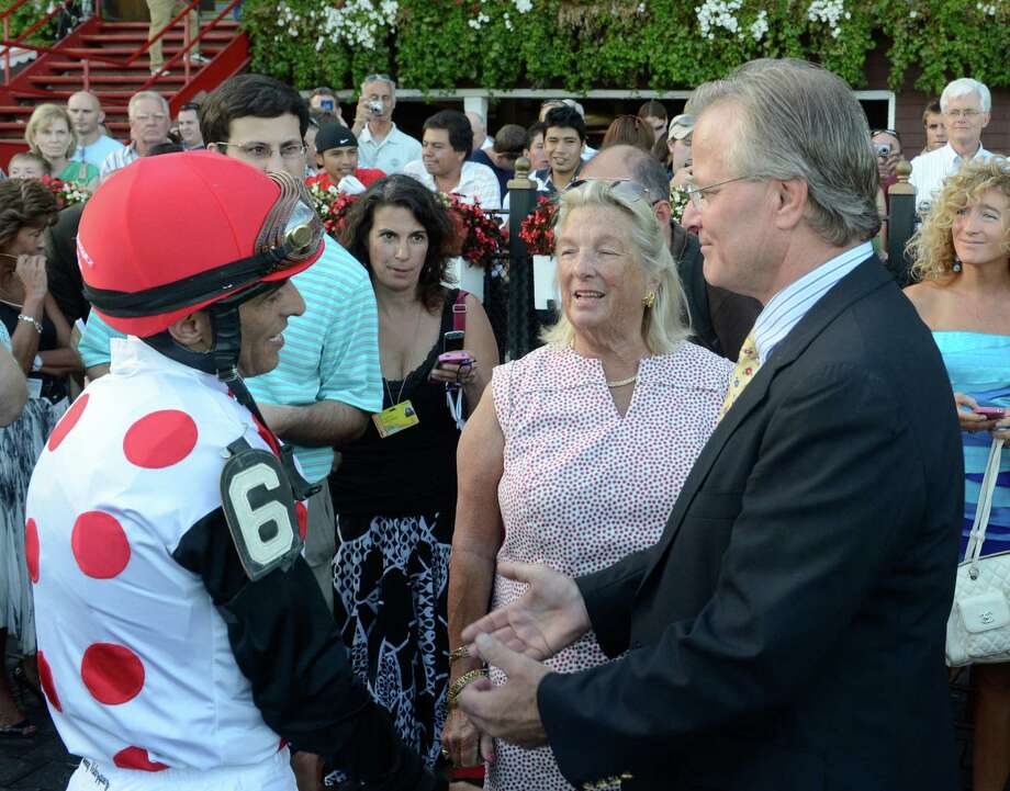 Jockey John Velazquez , left speaks with trainer William Mott, right as owner Charlotte Weber, center after riding To Honor and Service to the win in the 59th running of The Woodward Stakes at the Saratoga Race Course in Saratoga Springs, N.Y. Sept. 1, 2012.     (Skip Dickstein/Times Union) Photo: Skip Dickstein