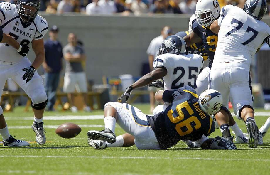 Cals' Keni Kaufusi, (56) forces a fumble on Nevada's Stefphon Jefferson, (25) in the third quarter, as the California Bears lose to the University of Nevada 31-24 at the newly renovated Memorial Stadium on Saturday September 1, 2012, in Berkeley, Calif. Photo: Michael Macor, The Chronicle