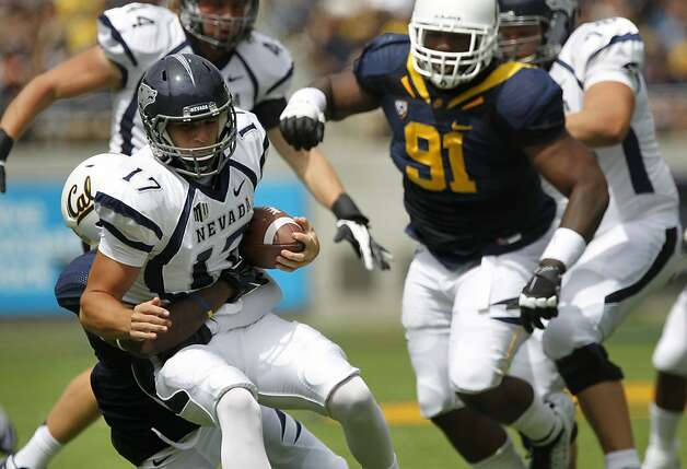 Wolf Pack quarterback, Cody Fajardo, (17) is sacked as the California Bears lose to the University of Nevada 31-24 at  the newly renovated Memorial Stadium on Saturday September 1, 2012, in Berkeley, Calif. Photo: Michael Macor, The Chronicle
