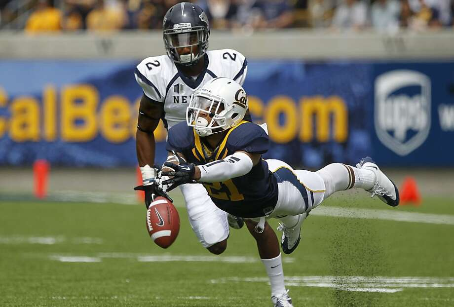Cal's Keenan Allen, (21) with the ball just out of reach in the first quarter, covered by Khalid Wooden (2), as the California Bears lose to the University of Nevada 31-24 at the newly renovated Memorial Stadium on Saturday September 1, 2012, in Berkeley, Calif. Photo: Michael Macor, The Chronicle