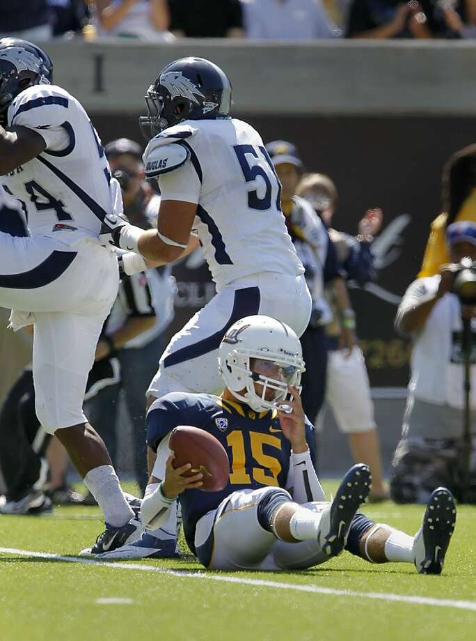 Cal quarterback Zach Maynard is slow getting up after being sacked in the fourth quarter, as the California Bears lose to the University of Nevada 31-24 at  the newly renovated Memorial Stadium on Saturday September 1, 2012, in Berkeley, Calif. Photo: Michael Macor, The Chronicle