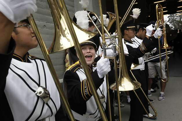 Cal band member Becky Horn gets excited before the start of the game, as the California Bears take on the University of Nevada at the newly renovated Memorial Stadium on Saturday September 1, 2012, in Berkeley, Calif. Photo: Michael Macor, The Chronicle