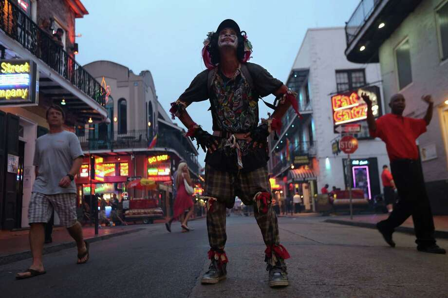 A clown stands on Bourbon Street on August 31, 2012 in the French Quarter of New Orleans, Louisiana. The French Quarter, Louisiana's most popular tourist attraction, returned to it's usual state of revelry, even as much of New Orleans was still without electricity, three days after Hurricane Isaac knocked out power to hundreds of thousands of people. Photo: John Moore, Getty Images / 2012 Getty Images