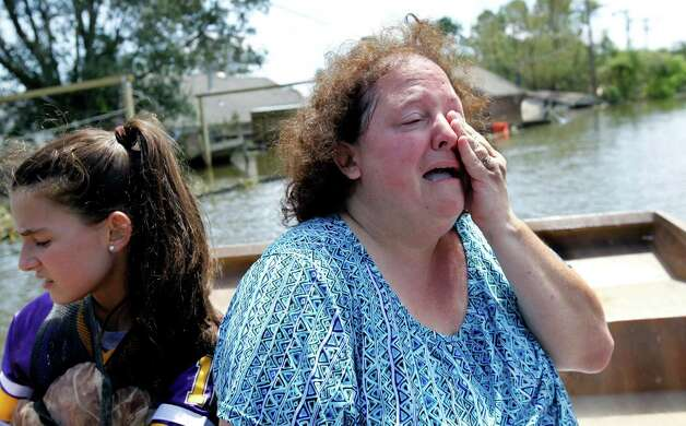 Angela Serpas cries as she sees her flooded home for the first time since Hurricane Isaac pushed a 10-foot storm surge into Braithwaite, La., Saturday, Sept. 1, 2012. Photo: Gerald Herbert, Associated Press / AP