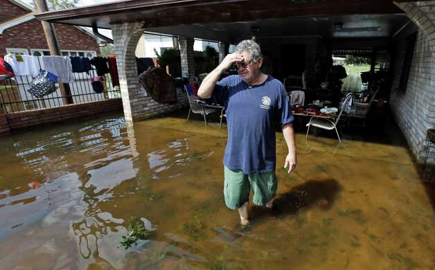 Peter Roccaforte reflects on the damage to his home caused by Hurricane Isaac in Reserve, La., Saturday, Sept. 1, 2012. Floodwaters cover many streets and power remains out in some areas. Louisiana's Public Service Commission said more than 443,000 customers remained without electricity around Louisiana on Saturday morning, days after Isaac crept across the state. Photo: David J. Phillip, Associated Press / AP