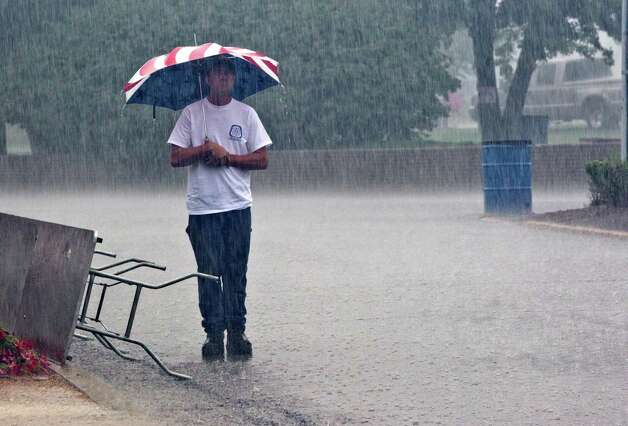 David Walker endures the rain from the remnant of Hurricane Isaac during opening ceremonies of the 29th Annual Labor's Family Day Picnic Saturday, September 1, 2012, at Columbian Park in Lafayette, Ind. Photo: Michael Heinz, Associated Press / Journal & Courier