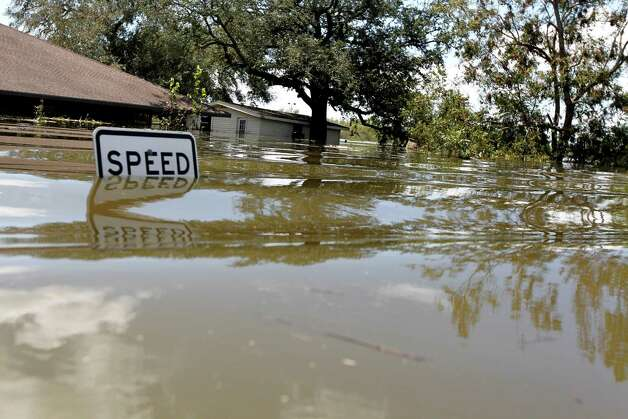 A flooded home from Hurricane Isaac is seen in Braithwaite, La., Saturday, Sept. 1, 2012. While New Orleans streets were bustling again and workers were returning to offshore oil rigs, thousands of evacuees couldn't return home to flooded low-lying areas of Louisiana and more than 400,000 sweltering electricity customers in the state remained without power. Photo: Gerald Herbert, Associated Press / AP
