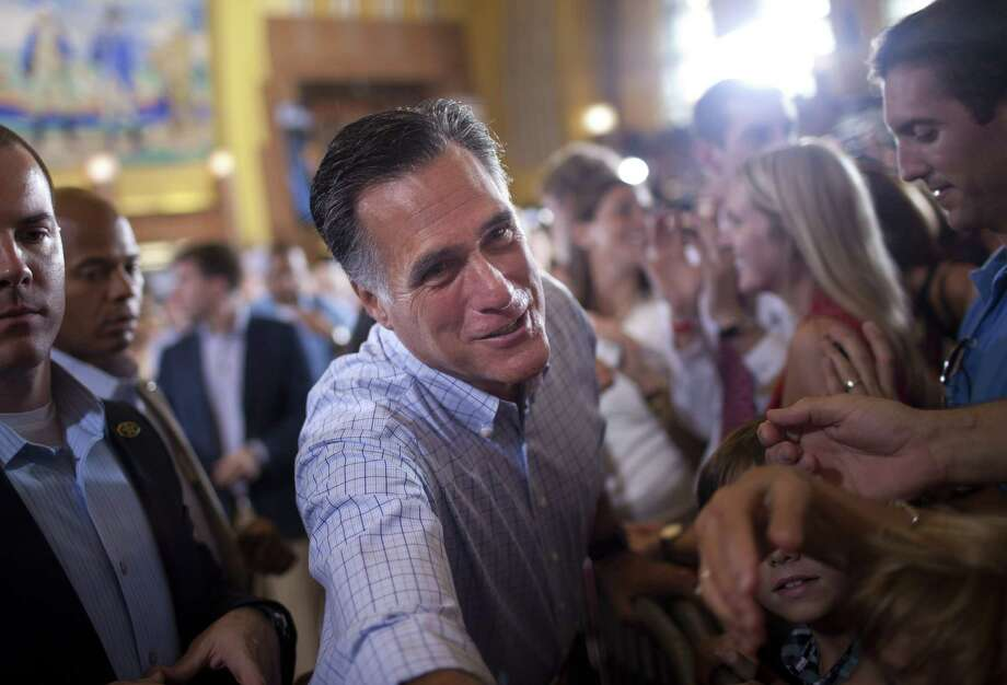 Republican presidential candidate, former Massachusetts Gov. Mitt Romney shakes hands during a campaign rally, Saturday, Sept. 1, 2012, in Cincinnati, Ohio.  (AP Photo/Evan Vucci) Photo: Evan Vucci