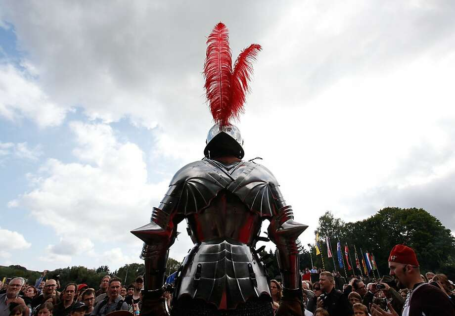 A man dressed as a knight from the Middle Ages in real armor takes part in the Knights' Tournament on September 1, 2012 in St. Wendel, Germany. The event marks the 500th anniversary of a visit by Emperor Maximilian I to St. Wendel. In contrast to other historical reenactments, St. Wendel organizers claim they have brought dedicated and highly-trained enthusiasts from across the globe and that all clothing, weapons, tools and other accessories have been made with great attention to detail and historical accuracy. The day's program included real jousts, authentic music, a display of coats of arms, demonstrations of Middle Ages artillery use and sword fighting and a full charge by opposing cavalry.  (Photo by Ralph Orlowski/Getty Images) Photo: Ralph Orlowski, Getty Images