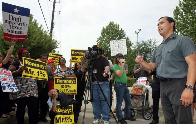 Joaquín Castro speaks to people protesting a visit from Republican presidential candidate Mitt Romney Thursday, March 20, 2012 at the Pearl. Photo: John Davenport, San Antonio Express-News / SAN ANTONIO EXPRESS-NEWS