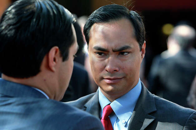 State Rep. Joaquín Castro (right) talks with his brother, San Antono Mayor Julián Castro as CPS announces OCI Solar Power as the choice to bring a 400 megawatt solar power plant to San Antonio at a LaVillita Assembly Hall event on January 11, 2012. Photo: Tom Reel, San Antonio Express-News / treel@express-news.net