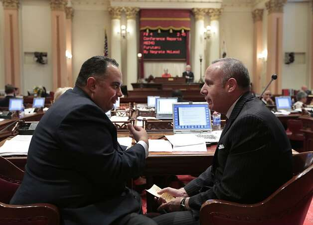 Assembly Speaker John Pérez, D-Los Angeles (left), and Senate President Pro Tem Darrell Steinberg, D-Sacramento, confer in Senate chambers as the two-year legislative session ends. Photo: Rich Pedroncelli, Associated Press