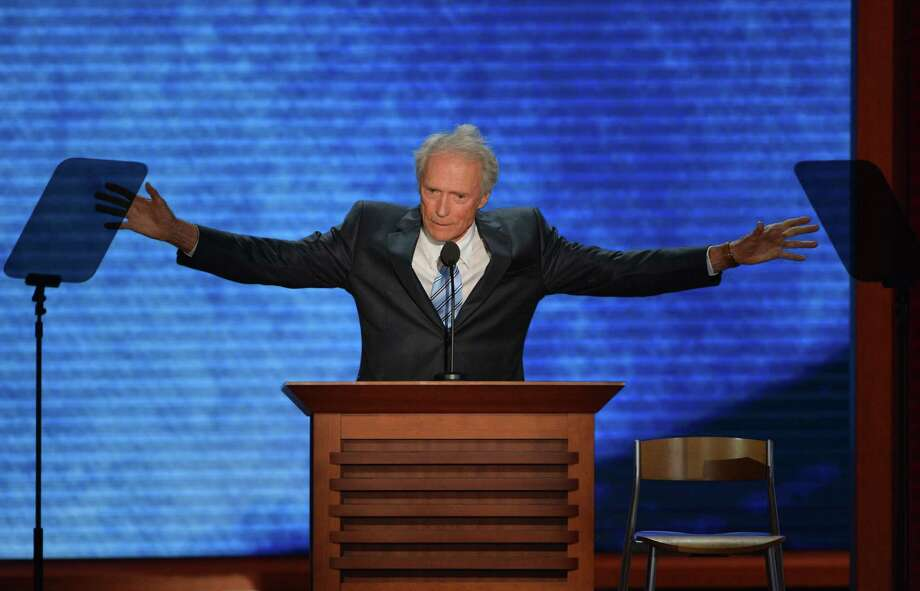 Actor-director Clint Eastwood speaks to the audience at the Tampa Bay Times Forum in Tampa, Florida, on August 30, 2012 on the last day of the Republican National Convention (RNC). The RNC culminates today with the formal nomination of Mitt Romney and Paul Ryan as the GOP presidential and vice-presidential candidates in the US presidential election.   AFP Stan HONDASTAN HONDA/AFP/GettyImages Photo: STAN HONDA / AFP