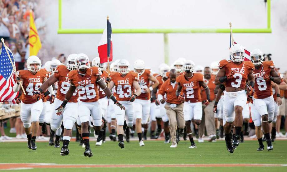 AUSTIN, TX - SEPTEMBER 1: The University of Texas Longhorns take the field prior to playing the Wyoming Cowboys on September 1, 2012 at Darrell K Royal-Texas Memorial Stadium in Austin, Texas. Photo: Cooper Neill, Getty Images / 2012 Getty Images