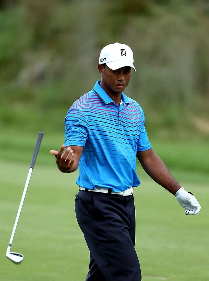 Tiger Woods throws his club towards the bag on the 15th hole during the second round of the Deutsche Bank Championship at TPC Boston on September 1, 2012 in Norton, Massachusetts.  (Photo by Warren Little/Getty Images) Photo: Warren Little, Getty Images
