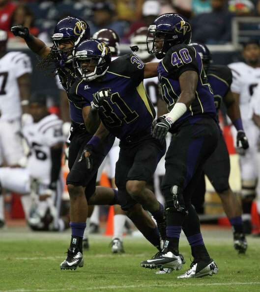 Prairie View's Brian Medlock celebrates his interception of Texas Southern with teammates Adrien Gra