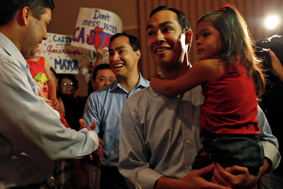 Mayor Julian Castro, right, holding his daughter, Carina, 3, and his brother, Joaquin Castro, left, greet supporters upon their arrival at the send-off party for their trip to the Democratic National Convention at the St. Paul Community Center in San Antonio on Saturday, Sept. 1, 2012. Photo: Lisa Krantz, San Antonio Express-News / San Antonio Express-News