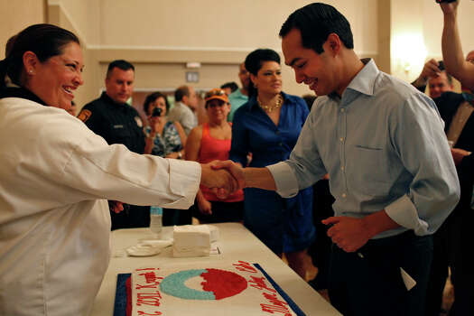 Mayor Julián Castro sees the cake for the send-off party for his trip to the Democratic National Convention at the St. Paul Community Center in San Antonio on Saturday, Sept. 1, 2012. Photo: Lisa Krantz, San Antonio Express-News / San Antonio Express-News