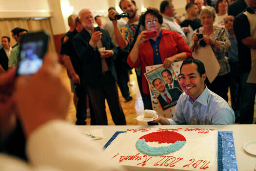 Mayor Julián Castro poses for a photograph with his cake during the send-off party for his trip to the Democratic National Convention at the St. Paul Community Center in San Antonio on Saturday, Sept. 1, 2012. Photo: Lisa Krantz, San Antonio Express-News / San Antonio Express-News