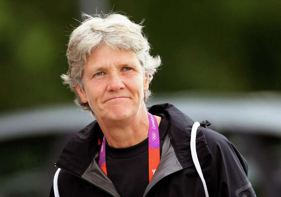 """FILE - This Aug. 2, 2012 file photo shows U.S. women's soccer head coach Pia Sundhage arriving at a soccer practice for the 2012 London Summer Olympics at Cochrane Park in Newcastle, England. After leading the team to two Olympic gold medals and its first spot in a World Cup final in more than a decade,  Sundhage is stepping down. Saturday's announcement of Sundhage's departure came just a few hours before the Americans kicked off their """"victory tour"""" to celebrate their gold medal at the London Olympics, where the Americans beat Japan 2-1 in a rematch of last year's World Cup final. The search for a new coach will begin immediately.  (AP Photo/Scott Heppell, File) Photo: SCOTT HEPPELL"""