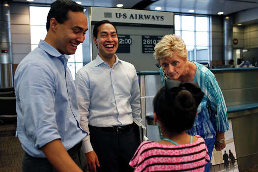 """And you're going to be a Democrat when you grow up,"" Bobbie Ducan, right, a delegate from Odessa, says to Brandy Ruiz, 9, of San Antonio, after Ruiz posed for a photo with Mayor Julián Castro, center, and his brother, Joaquín Castro, left, as they wait to board their plane for Charlotte, NC and the Democratic National Convention at the San Antonio International Airport on Saturday, Sept. 1, 2012. Photo: Lisa Krantz, San Antonio Express-News / San Antonio Express-News"