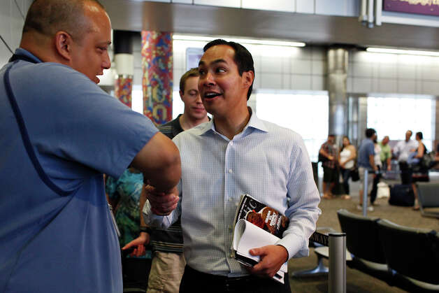Mayor Julián Castro, center, is wished good luck as he boards his flight to Charlotte, NC for the Democratic National Convention at the San Antonio International Airport on Saturday, Sept. 1, 2012. Photo: Lisa Krantz, San Antonio Express-News / San Antonio Express-News