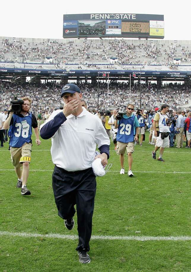 STATE COLLEGE, PA - SEPTEMBER 01: Head coach Bill O'Brien of the Penn State Nittany Lions runs off the field after losing 24-14 to the Ohio Bobcats at Beaver Stadium on September 1, 2012 in State College, Pennsylvania.  (Photo by Rob Carr/Getty Images) Photo: Rob Carr