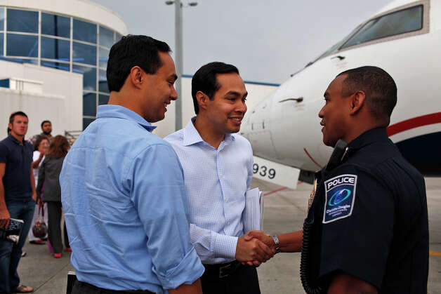 Mayor Julián Castro, center, and his brother, Joaquín Castro, left, are greeted upon their arrival in Charlotte, NC, for the Democratic National Convention on Saturday, Sept. 1, 2012. Photo: Lisa Krantz, San Antonio Express-News / San Antonio Express-News