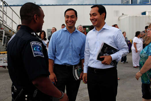 Mayor Julián Castro, right, and his brother, Joaquín Castro, left, are greeted upon their arrival in Charlotte, NC, for the Democratic National Convention on Saturday, Sept. 1, 2012. Photo: Lisa Krantz, San Antonio Express-News / San Antonio Express-News