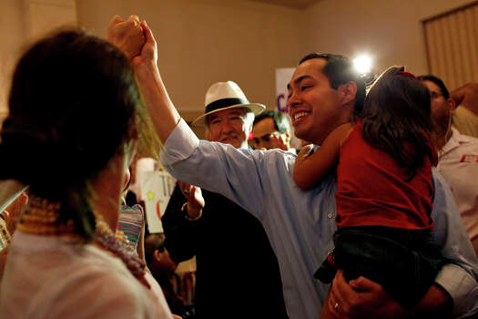 Mayor Julian Castro, right, holds his daughter, Carina, 3, as he greets supporters upon his arrival at the send-off party for his trip to the Democratic National Convention at the St. Paul Community Center in San Antonio on Saturday, Sept. 1, 2012. Photo: Lisa Krantz, San Antonio Express-News / San Antonio Express-News