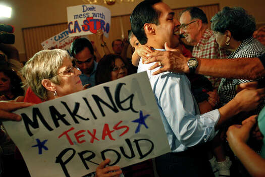 Mayor Julian Castro, holding his daughter, Carina, 3, is surrounded by supporters at the send-off party for his trip to the Democratic National Convention at the St. Paul Community Center in San Antonio on Saturday, Sept. 1, 2012. Photo: Lisa Krantz, San Antonio Express-News / San Antonio Express-News