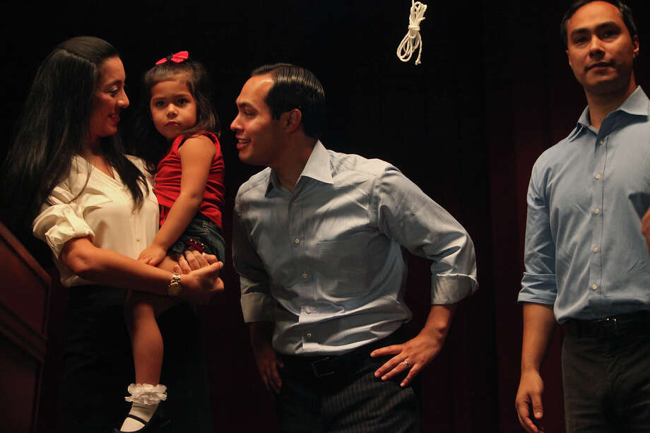 Mayor Julian Castro, center, stands with his wife, Erica Castro, their daughter, Carina, 3, and his brother, Joaquin Castro, right, on stage during the send-off party for their trip to the Democratic National Convention at the St. Paul Community Center in San Antonio on Saturday, Sept. 1, 2012. Photo: Lisa Krantz, San Antonio Express-News / San Antonio Express-News