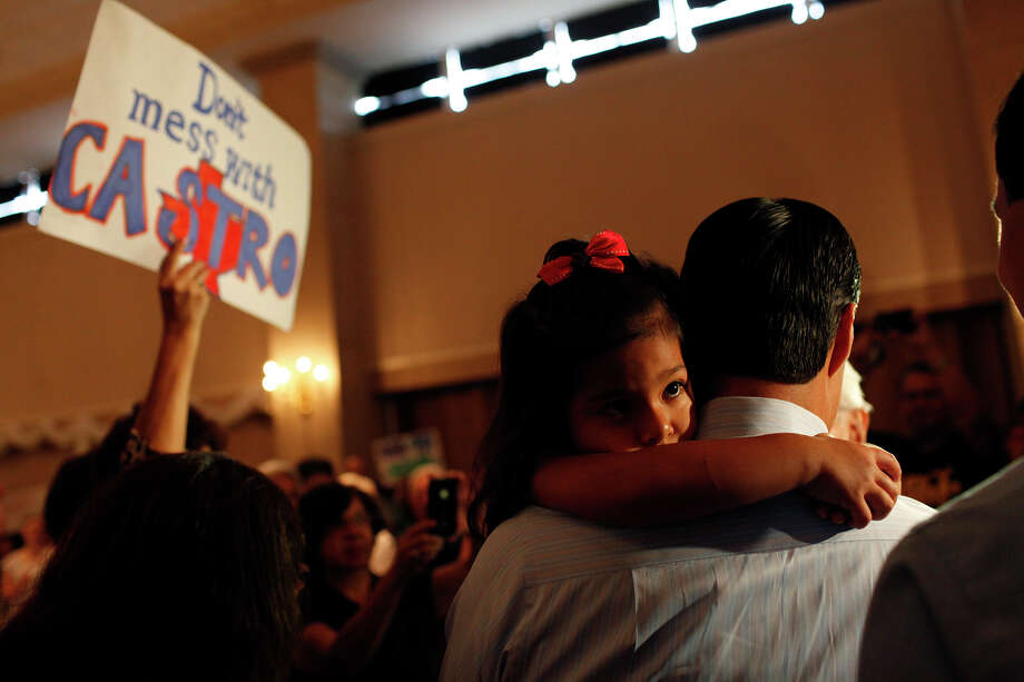 Carina Castro, 3, holds onto her father, Mayor Julian Castro, as he is surrounded by supporters at the send-off party for his trip to the Democratic National Convention at the St. Paul Community Center in San Antonio on Saturday, Sept. 1, 2012. Photo: Lisa Krantz, San Antonio Express-News / San Antonio Express-News