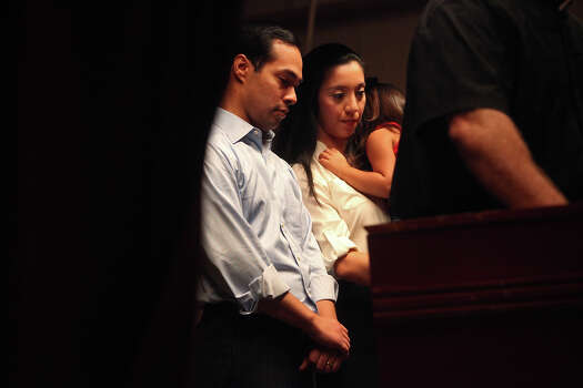 Mayor Julián Castro with his wife, Erica, and their daughter, Carina, 3, bow their heads in prayer during the send-off party for their trip to the Democratic National Convention at the St. Paul Community Center in San Antonio on Saturday, Sept. 1, 2012. Photo: Lisa Krantz, San Antonio Express-News / San Antonio Express-News