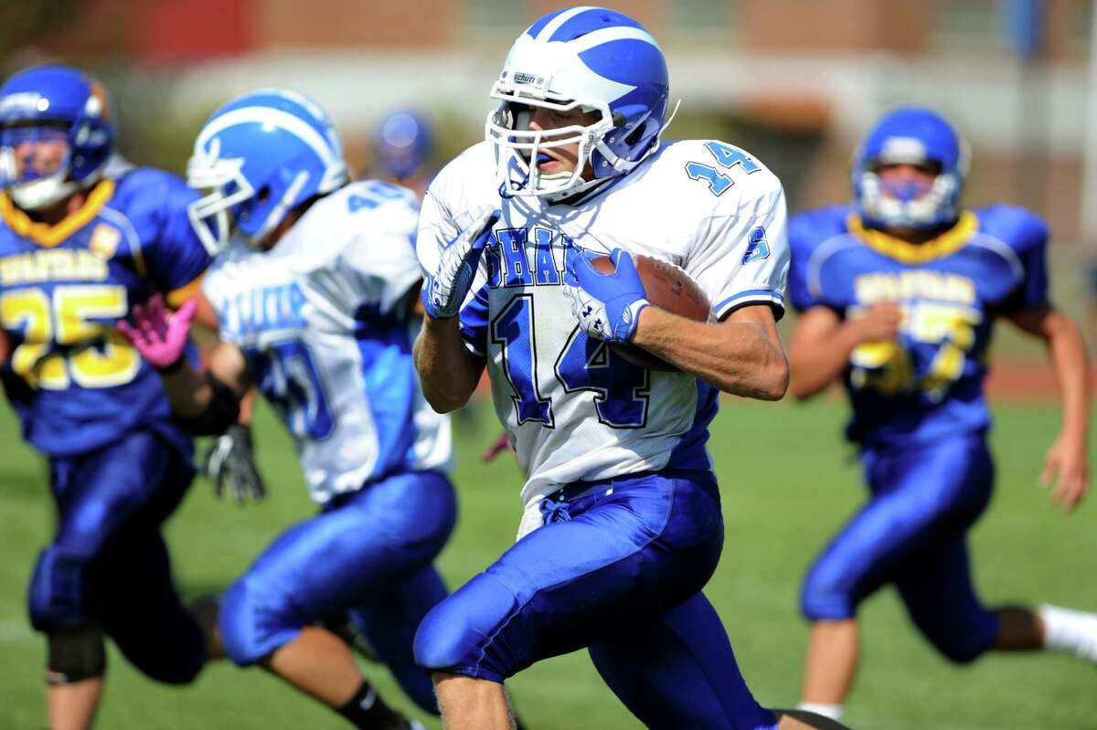 Shaker's Tyler Oppelt (14), center, carries the ball into the end zone during their football game against Queensbury on Saturday, Sept. 1, 2012, at Queensbury High in Queensbury, N.Y. The touchdown was called back because of a holding penalty. (Cindy Schultz / Times Union)