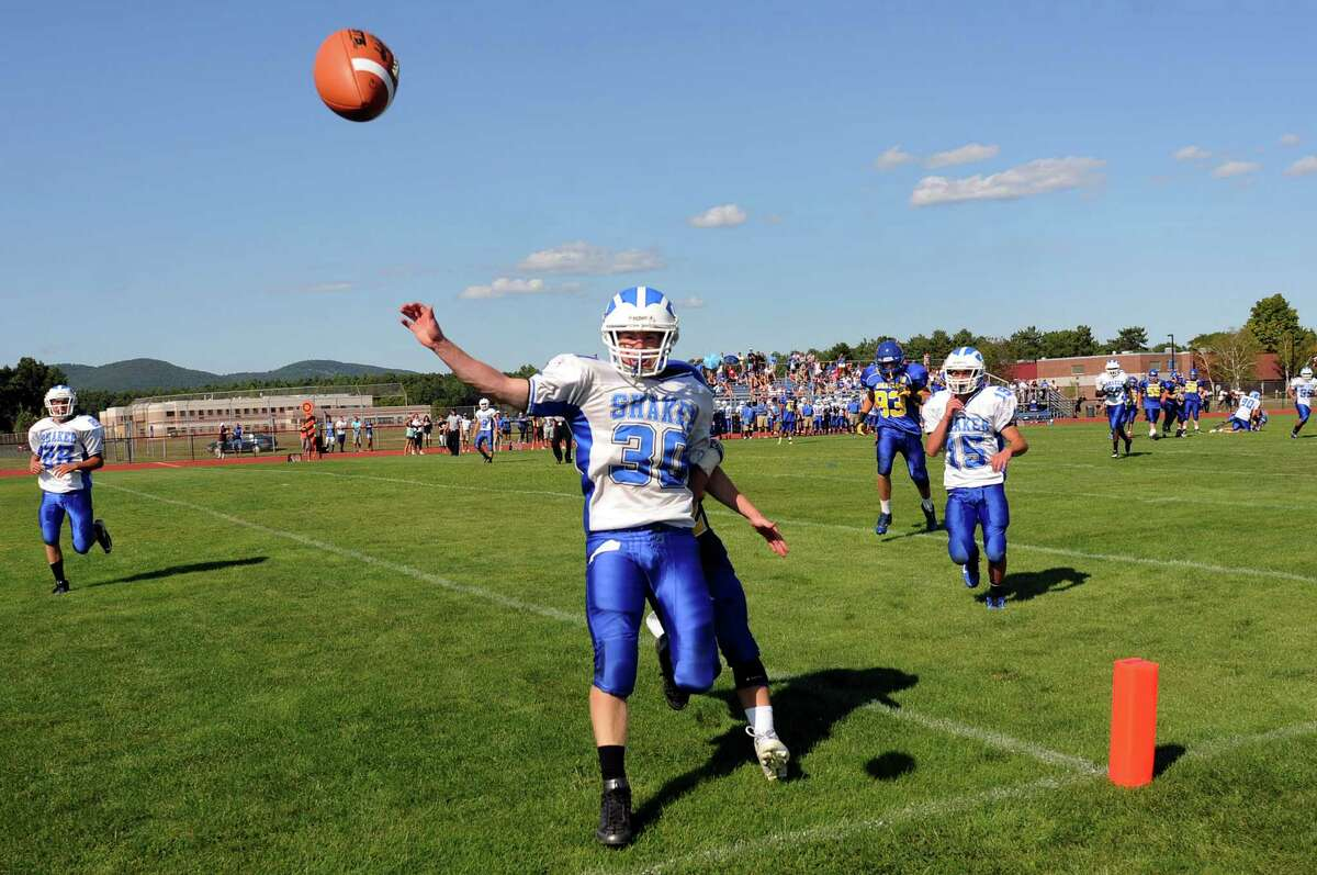 Shaker's Justin Safford (30), center, knocks away a Queensbury pass in the end zone during their football game on Saturday, Sept. 1, 2012, at Queensbury High in Queensbury, N.Y. (Cindy Schultz / Times Union)