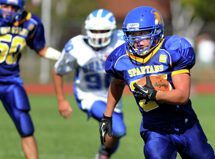Queensbury's Philip Wettersten (25), right, gains yards during their football game against Shaker on