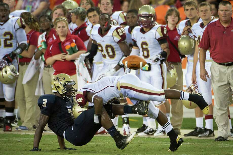 Klein Collins receiver Marcus Goodwon (3) fumbles as he is hit by Cy Woods defender Kendrick Jacobs during a high school football game at  BBVA Compass Stadium, Saturday, Sept. 1, 2012, in Houston. Photo: Smiley N. Pool, Houston Chronicle / © 2012  Houston Chronicle