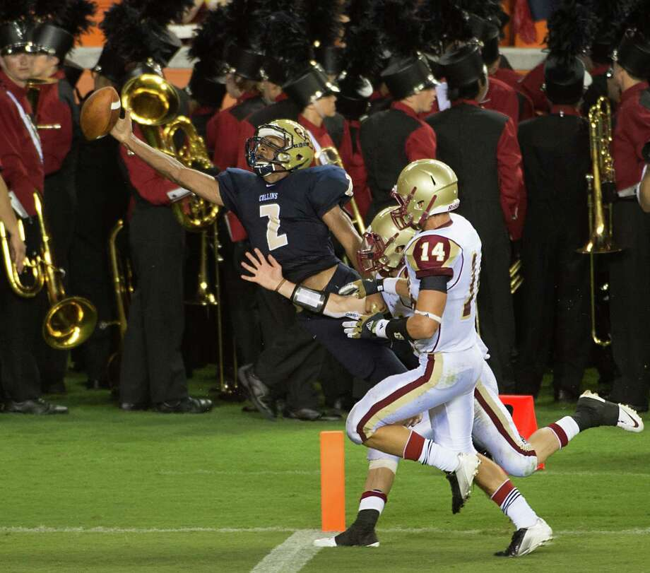 Klein Collins receiver Jordan Thomas (2) reaches for a pass against Cy Woods during a high school football game at BBVA Compass Stadium, Saturday, Sept. 1, 2012, in Houston. Photo: Smiley N. Pool, Houston Chronicle / © 2012  Houston Chronicle