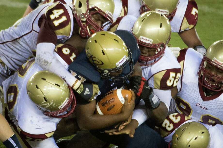 Klein Collins 35, Cypress Woods 14Klein Collins running back Jeremy Fair is swarmed by Cy Woods defenders during a high school football game at BBVA Compass Stadium, Saturday, Sept. 1, 2012, in Houston. Photo: Smiley N. Pool, Houston Chronicle / © 2012  Houston Chronicle