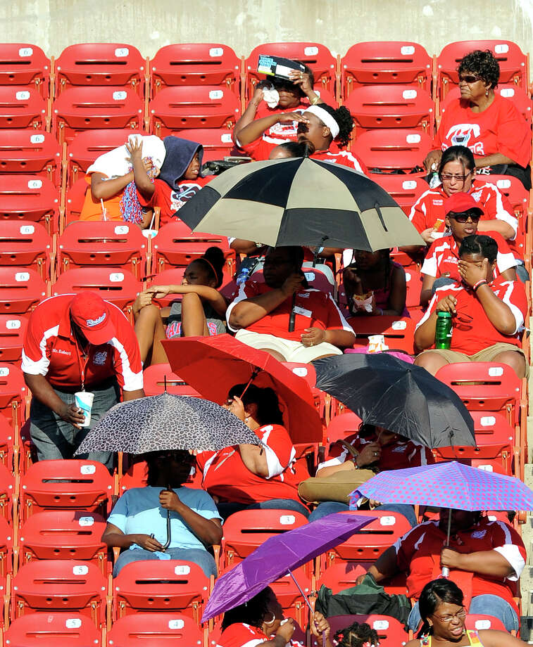 Skyline fans try to shield themselves from the sun in the first half during a Class 5A high school football game, Saturday, Sept. 31, 2012 at FC Dallas Stadium in Frisco, Texas. Photo: Matt Strasen, Special Contributor / Matt Strasen