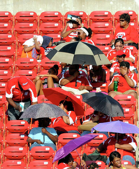 Skyline fans try to shield themselves from the sun in the first half during a Class 5A high school f