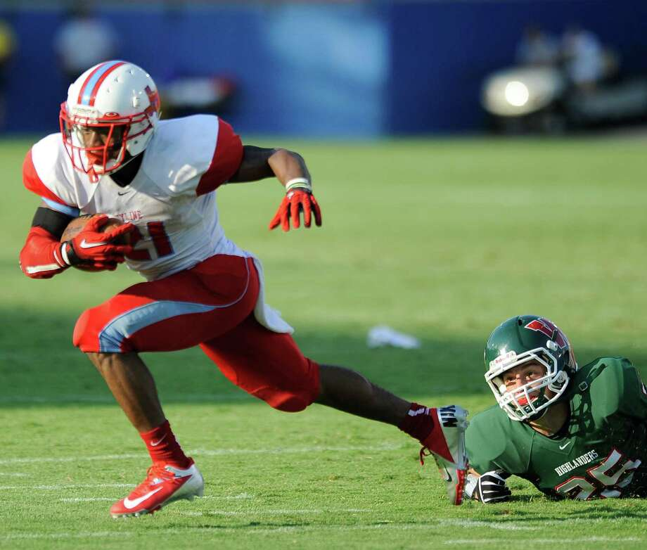 Skyline's Jordan Stevenson is tripped up by The Woodland's Christian Canion in the first quarter during a Class 5A high school football game, Saturday, Sept. 31, 2012 at FC Dallas Stadium in Frisco, Texas. Photo: Matt Strasen, Special Contributor / Matt Strasen
