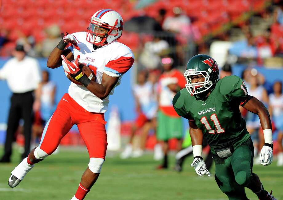 Skyline's RaShaad Samples catches a touchdown pass in front of The Woodlands Kolbi Brown in the first quarter during a Class 5A high school football game, Saturday, Sept. 31, 2012 at FC Dallas Stadium in Frisco, Texas. Photo: Matt Strasen, Special Contributor / Matt Strasen